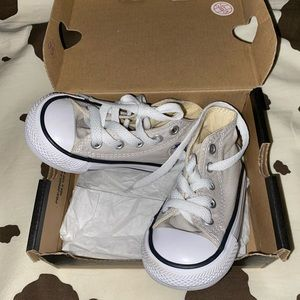 tan & white toddler Coverse high tops size 4